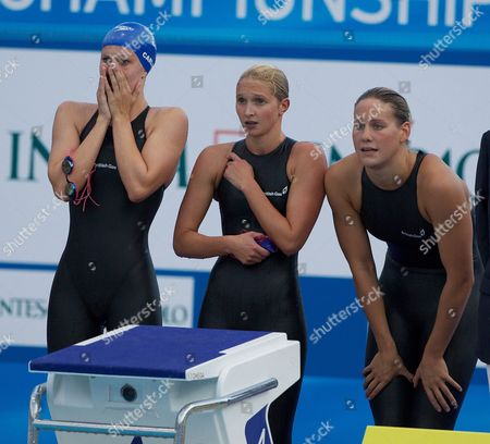 The Great Britain Women's 4 X 200m Relay Team of Jazmin Carlin Caitlin Mcclatchey and Joanne Jackson Watch As Rebecca Adlington Swims the Final Leg For the Bronze Medal Win Italy
