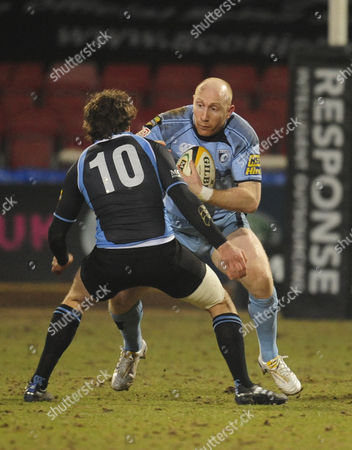 Ruaridh Jackson of Glasgow Warriors (10) Attempts to Tackle Tom Shanklin of Cardiff Blues