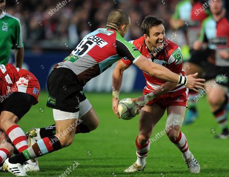 Mike Brown of Harlequins Tackles Rory Lawson of Gloucester Rugby United Kingdom Gloucester