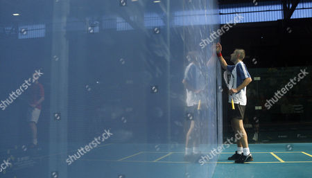 Ben Ford of England Wipes His Hands On the Glass Court During His First Round Match Against James Willstrop of England Reflected Left United Kingdom Manchester