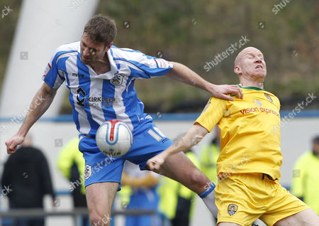 Jamie Mccombe of Huddersfield Town and Lee Hughes of Notts County United Kingdom Huddersfield