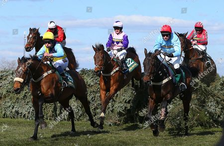 Oliver Greenall Riding Cool Friend (left) Clears the Last As He Leads But He Misses out On Victory to John Hamilton Riding Tartan Snow (far Right) United Kingdom Liverpool