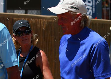Stock Image of Greg Norman of Australia Walks with Wife Chris Evert Following His Second Round of the Johnnie Walker Classic in Perthaustralia Australia Perth