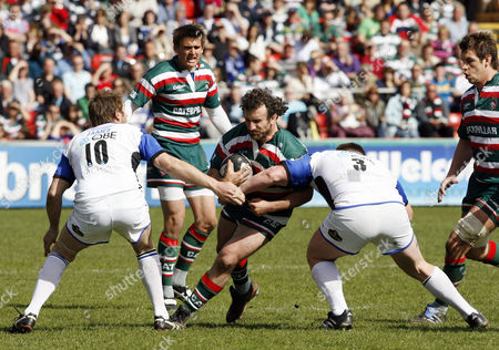 George Chuter of Leicester Tigers is Tackled by Butch James (left) and David Wilson of Bath United Kingdom Leicester