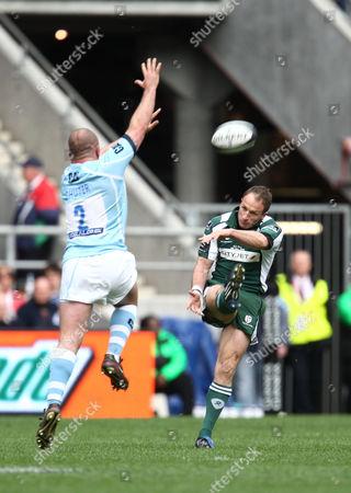 Mike Catt of London Irish Kicks the Ball Over George Chuter of Leicester Tigers United Kingdom London