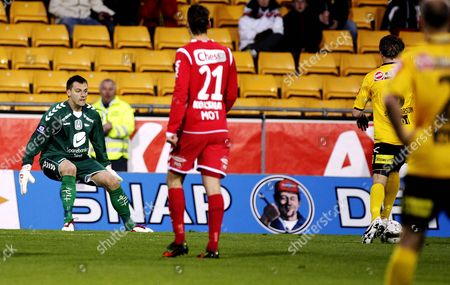 Lillestrom Sk's Bjorn Bergmann Sigurdarson (r Partially Hidden) is Allowed to Score an Equalising Goal by the Sk Brann Players Apart From Goalkeeper Piotr Leciejewski (l) Who Tries His Best to Make A Save Norway Lillestrom