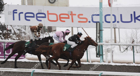 Jean Pierre Guillambert On Board Prince of Sorrento Wins the Third Race the Bet Premier League Football Betdaq Handicap Stakes Beating Transfixed Ridden by Richard Evans Into Second and Exceedthewildman Ridden by Richard Hughes Far Left