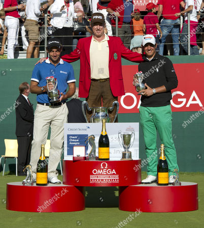Miguel Angle Jimenez of Spain Poses with the Omega European Masters Trophy and Wears the Winners Red Jacket As He Stands On the Podium with Runners-up Edoardo Molinari (italy) and Matteo Manassero (italy)