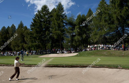 Miguel Angle Jimenez of Spain Pitches out of the Sand Trap