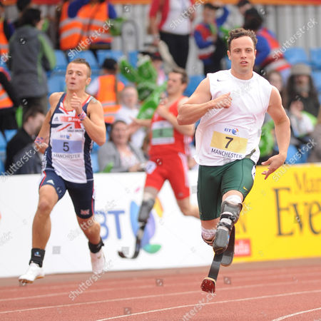 Oscar Pistorious (rsa Right) Who Finished First and Ian Jones (gbr Left) Who Finished Second Competing in Event 22 : T44 400m Men For Amputee & Les Autres During the Athletics at the Bt Paralympic World Cup at Sport City in Manchester