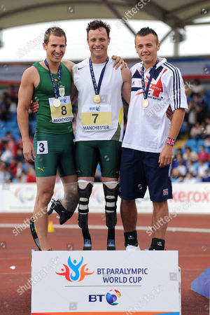 Arnu Fourie (rsa Left) Who Won Silver Oscar Pistorius (rsa Centre Who Won the Gold) and Ian Jones (gbr Right) Who Won the Bronze Medal Competing in Event 8 : T44 100m Men For Amputee & Les Autres During the Athletics at the Bt Paralympic World Cup at Sport City in Manchester