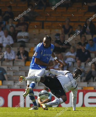 Aaron Brown of Stockport County Fouls Justin Richards of Port Vale United Kingdom Stoke