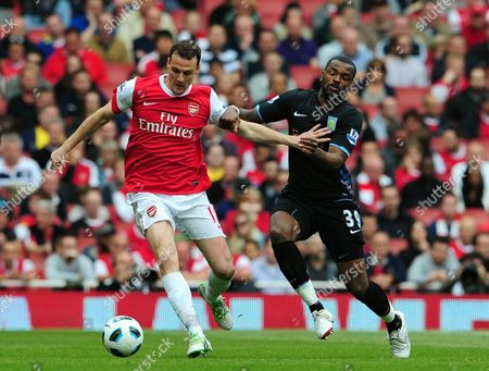 Sebastien Squillaci of Arsenal and Darren Bent of Aston Villa United Kingdom Reading