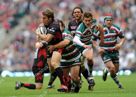Chrisa Wyles of Saracens is Tackled by George Chuter of Leicester Tigers United Kingdom London