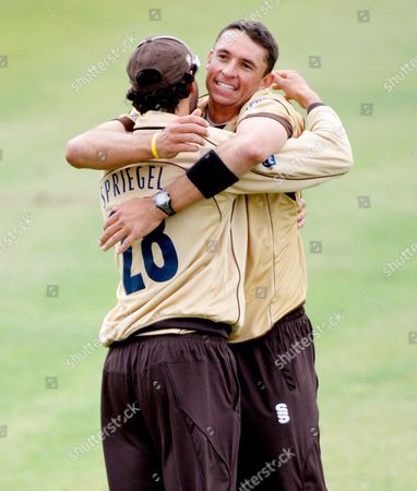 Andre Nel of Surrey Brown Caps Celebrates the Wicket of Will Smith of Durham Dynamos with Team Mate Chris Schofield Who Caught the Ball United Kingdom London