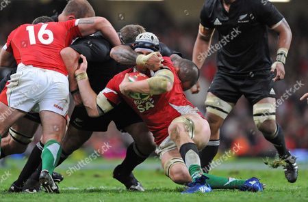 Ryan Jones of Wales is Tackled by Neemia Tialata of New Zealand Around the Face United Kingdom Cardiff