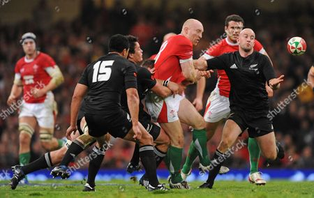Brendon Leonard of New Zealand Gets the Ball Away From Tom Shanklin of Wales United Kingdom Cardiff