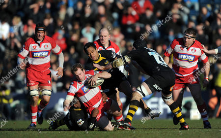 James Simpson-daniel of Gloucester is Tackled by Serge Betsen and Steve Kefu of Wasps United Kingdom Wycombe