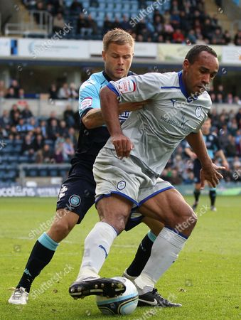 Danny Foster of Wycombe Wanderers in Action with Chris O'grady of Sheffield Wednesday United Kingdom Wycombe