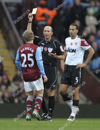 Barry Bannan of Aston Villa Receives A Yellow Card From Referee Mike Reid United Kingdom Birmingham
