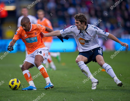 Sam Ricketts of Bolton Wanderers Challenges Elliot Grandin of Blackpool United Kingdom Bolton