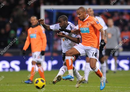 Fabrice Muamba of Bolton Wanderers Challenges Elliot Grandin of Blackpool United Kingdom Bolton