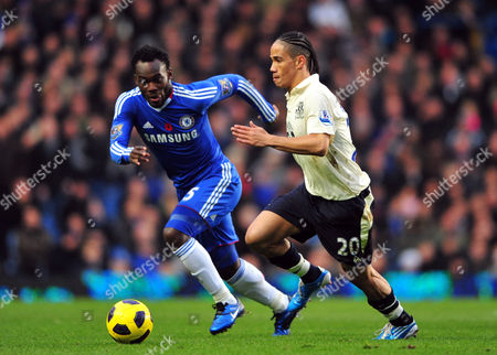 Stock Photo of Stephen Pienaar of Everton and Michael Essien of Chelsea United Kingdom London