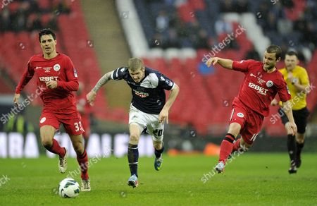Andy Keogh of Millwall Tries to Break Free From Paul Scharner and Shaun Maloney of Wigan Athletic United Kingdom London