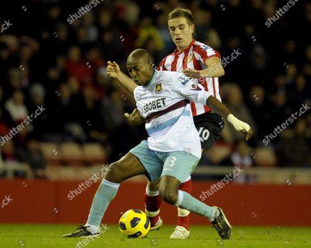 Jordan Henderson of Sunderland and Luis Boa Morte of West Ham United United Kingdom Sunderland