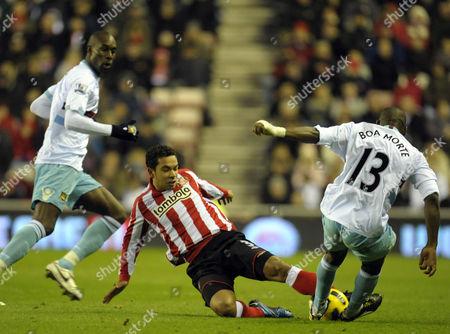 Kieran Richardson of Sunderland Jumps Into A Tackle with Luis Boa Morte of United Kingdom Sunderland