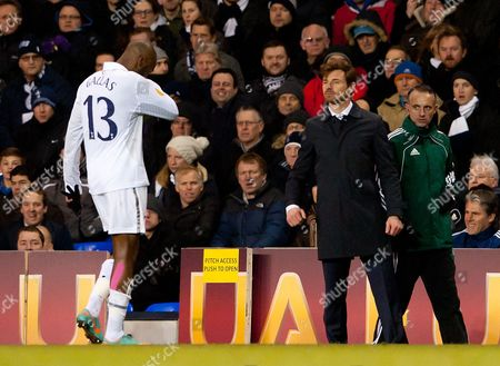 William Gallas Walks Off the Pitch As Tottenham Hotspur Manager Andre Villas-boas Watches United Kingdom London