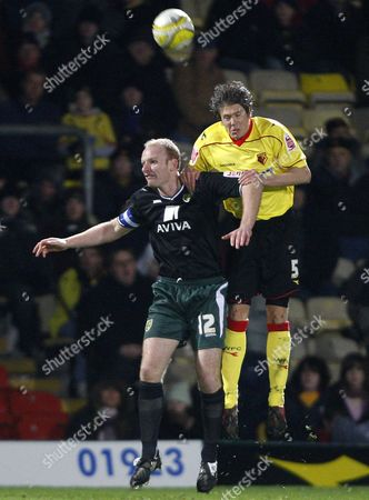 Leigh Bromby of Watford and Gary Doherty of Norwich Jump For the Ball United Kingdom London