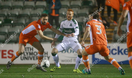 Plymouth's Ryan Taylor can't beat Blackpool Blackpool's Andy Taylor  during the Sky Bet League 2 match between Plymouth Argyle and Blackpool on Tuesday 7h March 2017 at Home Park, Plymouth, Devon - Photo: Dave Rowntree/PPAUK