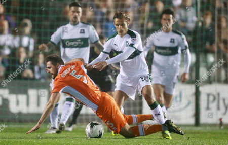 Blackpool's Clark Robertson falls in the penalty box after a tackle by Plymouth's Oscar Threlkeld  during the Sky Bet League 2 match between Plymouth Argyle and Blackpool on Tuesday 7h March 2017 at Home Park, Plymouth, Devon - Photo: Dave Rowntree/PPAUK