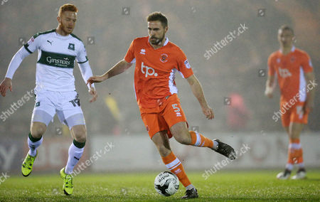 Plymouth's Ryan Taylor battles for the ball with Blackpool's Clark Robertson  during the Sky Bet League 2 match between Plymouth Argyle and Blackpool on Tuesday 7h March 2017 at Home Park, Plymouth, Devon - Photo: Dave Rowntree/PPAUK