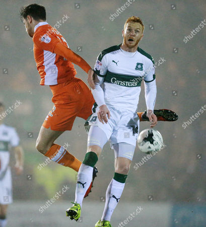Plymouth's Ryan Taylor  challenges for the ariel ball with Blackpool Macaulay Gillesphey  during the Sky Bet League 2 match between Plymouth Argyle and Blackpool on Tuesday 7h March 2017 at Home Park, Plymouth, Devon - Photo: Dave Rowntree/PPAUK