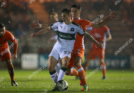 Plymouth's Craig Tanner holds off Blackpool's Ian Black  during the Sky Bet League 2 match between Plymouth Argyle and Blackpool on Tuesday 7h March 2017 at Home Park, Plymouth, Devon - Photo: Dave Rowntree/PPAUK