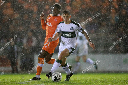 Blackpool's Bright Osayi-Samuel chases after  Plymouth's Craig Tanner  during the Sky Bet League 2 match between Plymouth Argyle and Blackpool on Tuesday 7h March 2017 at Home Park, Plymouth, Devon - Photo: Dave Rowntree/PPAUK