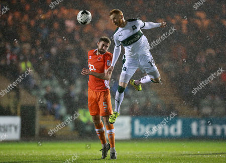 Plymouth's Ryan Taylor challenges for the ariel ball with Blackpool's Clark Robertson  during the Sky Bet League 2 match between Plymouth Argyle and Blackpool on Tuesday 7h March 2017 at Home Park, Plymouth, Devon - Photo: Dave Rowntree/PPAUK