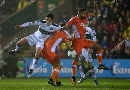 Plymouth's Ryan Donaldson battles for the ball with Blackpool's Brad Potts  during the Sky Bet League 2 match between Plymouth Argyle and Blackpool on Tuesday 7h March 2017 at Home Park, Plymouth, Devon - Photo: Dave Rowntree/PPAUK
