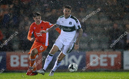 Plymouth's Sonny Bradley turns away from Blackpool's Jordan Fiores  during the Sky Bet League 2 match between Plymouth Argyle and Blackpool on Tuesday 7h March 2017 at Home Park, Plymouth, Devon - Photo: Dave Rowntree/PPAUK