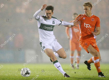 Plymouth's Ryan Donaldson holds off Blackpool's Brad Potts  during the Sky Bet League 2 match between Plymouth Argyle and Blackpool on Tuesday 7h March 2017 at Home Park, Plymouth, Devon - Photo: Dave Rowntree/PPAUK