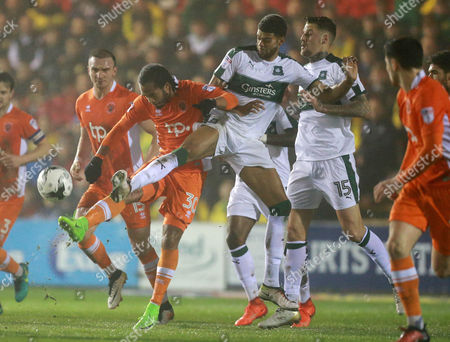 Plymouth's Jake Jervis battles for the ball with Blackpool's Nathan Delfouneso  during the Sky Bet League 2 match between Plymouth Argyle and Blackpool on Tuesday 7h March 2017 at Home Park, Plymouth, Devon - Photo: Dave Rowntree/PPAUK