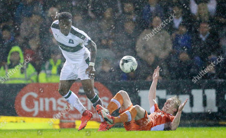 Plymouth's Yann SongoÕo battles for the ball with Blackpool's Mark Cullen  during the Sky Bet League 2 match between Plymouth Argyle and Blackpool on Tuesday 7h March 2017 at Home Park, Plymouth, Devon - Photo: Dave Rowntree/PPAUK