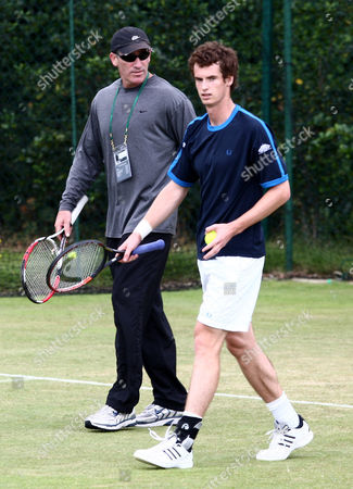 Andy Murray of Great Britain on a practice court with his coach Brad Gilbert