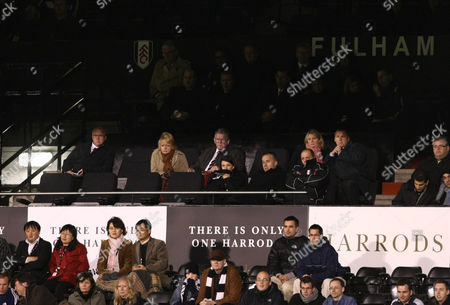 BBC television commentator John Motson, centre, looks on with colleague Ray Stubbs, far right