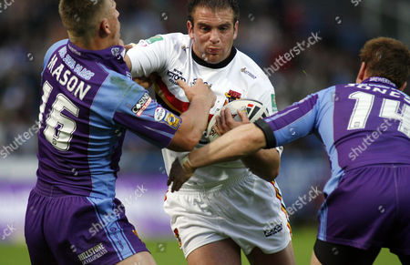 Stock Picture of Andy Lynch of Bradford Bulls battles his way through Keith Mason and Stuart Jones of Huddersfield Giants