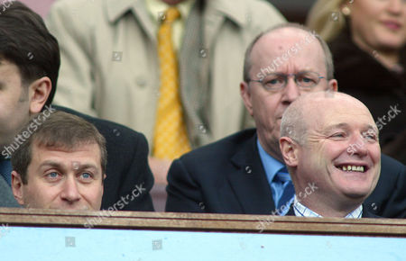 Chelsea Chief Executive Peter Kenyon (r) laughs as he sits in the stands next to Chelsea's billionaire owner Roman Abramovic