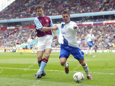 Aston Villa's Ronny Johnsen tugs back Chelsea's Adrian Mutu