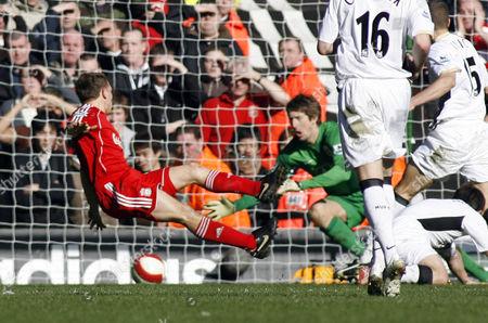 Manchester United Goalkeeper Edwin Van Der Saar saves the shot from Craig Bellamy of Liverpool`